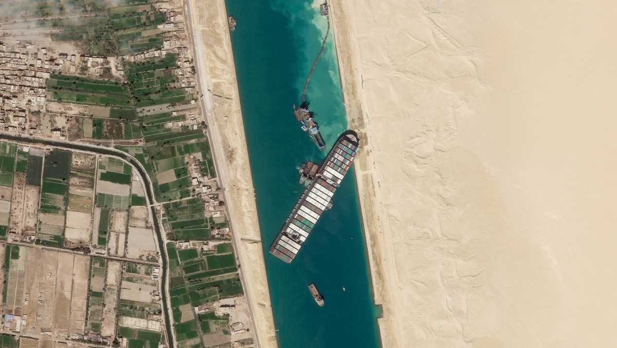 Canal service provider says container ship in Suez set free