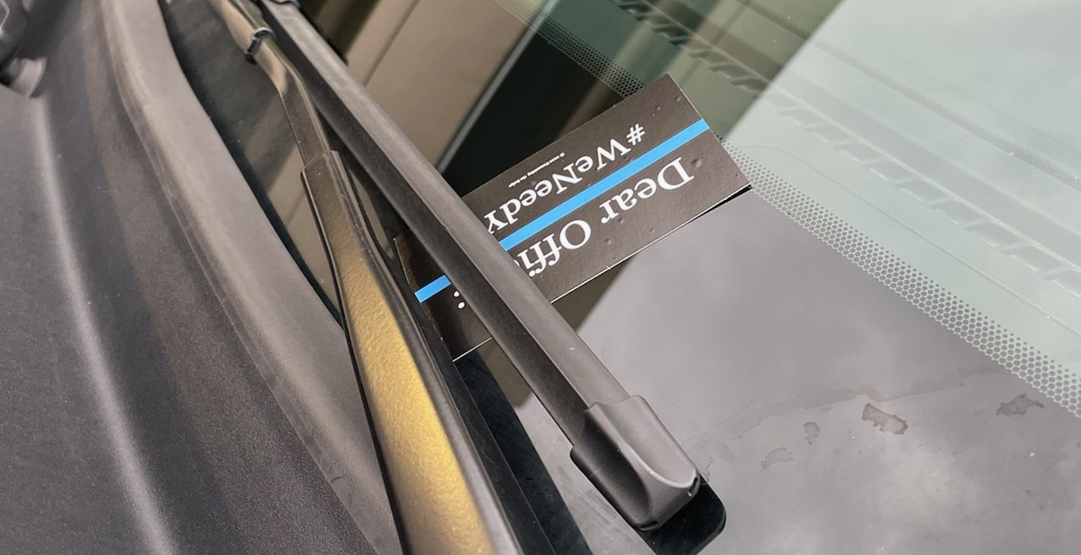 Kansas City officer finds #WeNeedYou business card on patrol car