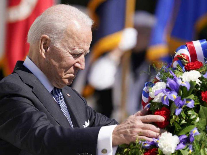 President Biden commemorates war dead at Arlington National Cemetery