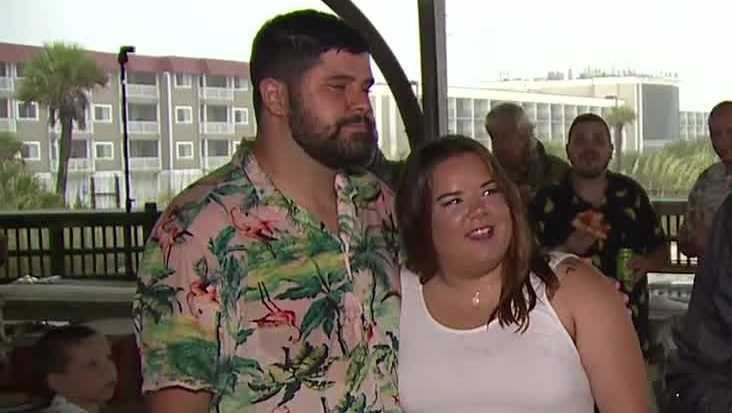 Couple ties the knot during tropical storm