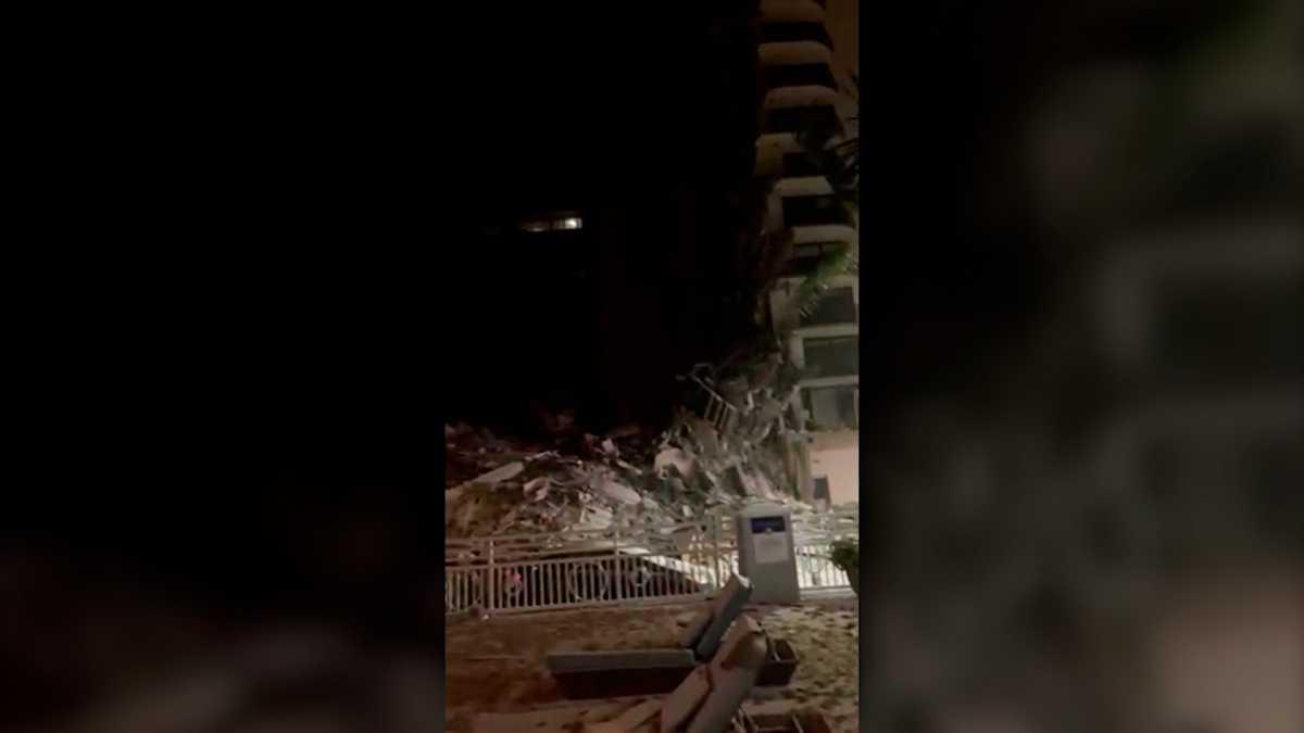 Video shows fallen debris, water in condo garage moments before collapse
